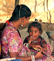 Gujarat, on the way (Monika-b) Tags: baby mother woman dress flower smile india gujarat