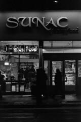 Manhattan street scene (Wilmarco Imaging) Tags: analogue analog film tmz night p3200 highiso streetphotography nyc manhattan boutique december monochrome newyorkcity newyork usa america manualfocus primelens people food emporium