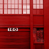 florid facade (msdonnalee) Tags: red rouge rot rojo facade facciate fachada urbangeometry window ventana fenster janela finestra garagedoor squareformat 160 monochrome colorenhancement