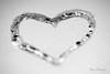 Only one heart... (Maria Godfrida) Tags: 7dwf closeup macro bw blackandwhite sparkling shining heart love heartshaped one bokeh blur tamron