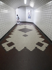 The Tile Tunnel (Steve Taylor (Photography)) Tags: 4 poster architecture white brown tile lady woman uk gb england greatbritain unitedkingdom london shape pattern tunnel passageway mosaic