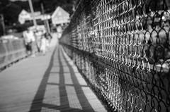 Boothbay Harbor bridge (HFF) (Rabican7) Tags: maine bridge hff fence friday happy monochrome blackandwhite lines bokeh depth walking footbridge harbor bay people photography boothbayharbor