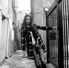 La petite crapule IV (lizardking_cda) Tags: hasselblad medium moyen format film analog kodak trix portrait model shooting photoshoot beautiful belle woman femme fille girl nice nizza france côte azur riviera vieuxnice collineduchâteau prom promenadedesanglais sea mer méditerranée eoshe chercherlafemme fashion town ville urban glamour sexy fun smile sourire badass nasty coat manteau automne autumn fall bw nb filmisnotdead fine art balade walk argentique mood spleen melancholy mélancolie écharpe scarf jean bottes boots