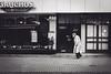 Amsterdam/Gauchos (Zesk MF) Tags: elderly man gaucho movement people candid street hat hut black white bw mono walking amsterdam leute zesk mf nikon 35mm