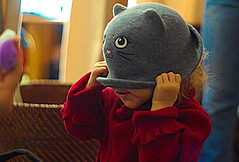 Sometimes it's the only choice ;-) (Clever Poet) Tags: hiding from all this holiday activity adorable little girl wearing big cat hat smiling laughing