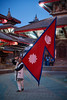 Nepali man with Nepali flag posing for local tourists, Durbar Square, Katmandu (Alex_Saurel) Tags: asia whitesclothes portray culture tradition redbricks architecture photoreport fullbody posing nepaliclothes drapeaunépalais day asian reportage traditionnalclothes travel 35mmprint giantflag portraiture pagodenewar people flag nepal traditional photospecs bricks newariart newariarchitecture portrait architecturenewar planitalien imagetype place briques planpied pagodas lifestyles asie photojournalism newaripagoda streetscene scans pose pagode redflag drapeaurouge stockcategories time photoreportage sony50mmf14sal50f14