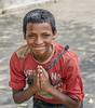 An honor to meet you (Pejasar) Tags: boy street candid newdelhi india vendor greeting