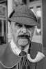 The Detective (wyojones) Tags: texas galveston dickensonthestrand christmas holiday festival victorian gentleman man guy hat detective pipe cloak thestrand mustache sherlock holmes blackandwhite bw greyscale monochromatic
