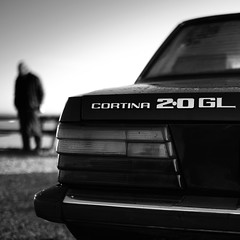 Classic (Andrew Malbon) Tags: ford cortina classic vintage car boot taillight cluster stripes 20 grandlux man portrait bokeh depthoffield shortdepthoffield wideangle wideopen summilux leica leicam9 m9 monochrome blackwhite portsmouth eastney bumper font text proud