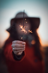 Happy New Year - 1/365 (der_peste (on/off)) Tags: woman person bokeh blur dof sparkler sparkle newyear happynewyear color hat colors hand shallowdepthoffield sonya7ii sel85f14gm