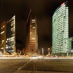 Three large tower blocks at night thumbnail