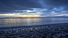 Pebbles (Paul Rioux) Tags: beach waterfront sea ocean seascape seashore seaside waves rocks stones morning sunrise clouds calm water reflection prioux