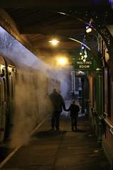 Steam Generations (tact1) Tags: trainstation sign ef100mm britain england nightimage canon6d nighttime green railwayplatform platform railway people steam train bluebellrailway steamtrain