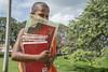 A lot to learn with a hidden smile (Christoph H-P) Tags: monk novice buddhism buddhist school learning reading anuradhapura ceylon religion student smile walk knowledge wisdom hiding face buddha sadu sacred