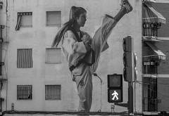 Martial arts supersized (Dan Österberg) Tags: martialarts karate training exercise practice girl woman female person wall painting art graffiti walk trafficlight bw building scale size oversized