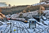 Bleak in the Peaks (whosoever2) Tags: england unitedkingdom uk gb greatbritain nikon d7100 december 2017 railway railroad train peakforest derbyshire peakdistrict highpeak dbcargo class66 66207 snow ice winter cold semaphore signal box track