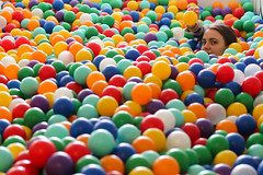 I can throw this to you (Josiedurney) Tags: summer eastlondon summerinthecity londonlife fun hipster cool birthday towerhamlets university colour ballpit balls child children play boxpark shippingcontainer shoreditch girl cute smile camera action