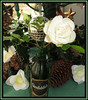 Christmas Rose (M E For Bees (Was Margaret Edge The Bee Girl)) Tags: rose bottle christmas flower decoration white green blooming winter celebration mirrorball cones holly