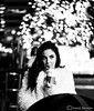 Christmas Coffee (Samrat_Banerjee) Tags: woman young adult girl smile coffee jacket cold winter christmas bokeh individuality outdoor simplcity feminity female fur hair sweet good looking makeup sony mirrorless a7riii a7rm3 a7r3 chair cheeks usa philadelphia night street ice cream bw black blackandwhite monochrome