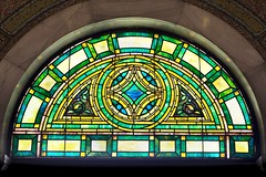 Stain glass window transom light in the historic 1908 Lakewood Memorial Chapel in Minneapolis, Minnesota,  The chapel was designed by architect Harry Wild Jones. (thstrand) Tags: 19001909 1908 1909 american arc arch arches architecturaldetail architecture art arts artwork building buildings builtstructure chapels church colorful coolcolors decorativeart design early20thcentury elaborate greencolor harrywildjones historicsite history inside interior interiors lakewoodcemetery mn memorialchapel minneapolis minnesota nationalregisterofhistoricplaces nobody ornate religion religious sanctuary semicircle stainglasswindow structures tile tiles transomlight us usa unitedstatesofamerica visualarts windows
