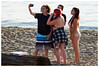 Just a quick selfie and then we'll eat the pizza (HereInVancouver) Tags: friends youngwomen candid streetphotography vancouverswestend selfie group outdoors people beach englishbaypark water ocean pacific log pizzabox canong3x vancouver bc canada thingstodobythewater
