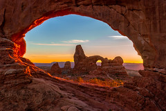 Turret Arch through Window Arch in Arches National Park (NickSouvall) Tags: arch arches national park window frame turret moab utah orange rock desert southwest geology sunset glow red clear sky haze sunlight light warm color adventure hike discover nature landscape photo photography picture photographyer explore