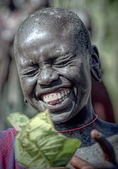 Ethiopia : Kibish, Surma people #10 (foto_morgana) Tags: africa afrika afrique analogphotography analogefotografie caractère character editorialonly ethiopia ethiopië ethnic ethnicity ethnie etnia etniciteit glimlach karakter kibish lachen lauch nikoncoolscan nomodelrelease omovallei omovalley outdoor people persoonlijkheid photographieanalogue portrait portret siurma smile smiling sourire suri traditionalculture travelexperience tribal tribe vallebajodelomo valléedelomo vuescan
