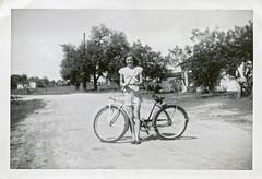 Teenage Girl Posing with Bicycle, 1948 (StevenM_61) Tags: teenagegirl bicycle 1940s 1948 foundphotograph