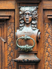 Knocker (markb120) Tags: knocker lever handle grip arm hilt handgrip wood face person countenance image visage front girl lady maiden lass maid puss woman female she wife oldwoman feminine