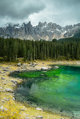 Lago di Carezza (marcovannotti) Tags: nature landscape sky clouds lake colours forest mountains trees water pond italy südtirol karersee