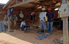 Shaping (LeftCoastKenny) Tags: madagascar antananarivo day13 workers cutting bending