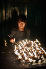 Tibetan girl lighting buddhist candles, Boudhanath, Kathmandu, Nepal (Alex_Saurel) Tags: portrait beautifull beauté portraiture portray halfbody asie culture 35mmprint scans candles asian pattern candle work motif bouddhisme buddhism people khāsacaitya lightingcandles tibetangirl boudhanath jeunefilletibétaine asia oillamp tibétaine streetscene khāsti travel sanctuairebouddhiste lifescene बौद्धनाथ imagetype buddhistsanctuary photospecs photoreport jarungkhashor beauty photoreportage reportage kathmandu nuit bouddhanath night bodnath byarungkhashor photojournalism main religion stockcategories hand bougies plantaille traditional time katmandou tradition nepal scènedevie lifestyles sony50mmf14sal50f14