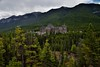 Nestled in a Hillside of Evergreens and Sulphur Mountain as a Backdrop (Banff National Park) (thor_mark ) Tags: nikond800e lookingssw day2 triptoalbertaandbritishcolumbia banffnationalpark capturenx2edited colorefexpro surprisepoint surprisecorner banffspringshotel sulphurmountain rockymountains canadianrockies southerncontinentalranges southbanffranges outside nature landscape overcast mountains mountainsindistance mountainsoffindistance mountainside hillsides trees hillsideoftrees evergreens hotel canadianflag flag flagpole portfolio project365 banff alberta canada