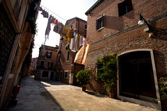 Washing Clothes (Katka S.) Tags: venice venezia italy city old building architecture clothes rope wet washing sun dry dying street empty sunset shadow alley door houses home