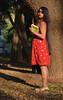 A girl in Red (Satyajit Mazumder) Tags: red long hair outdoor sun evening park removedfromstrobistpool nostrobistinfo seerule2