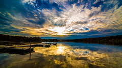 Golden Sunset (Robert E Dawson Jr) Tags: sunset sun lake water clouds cloud cloudy reflection dock pennsylvania gold golden blue nikon 12mm wide