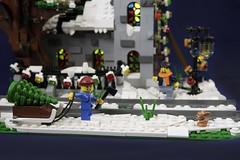 Winter Village Church - Caught (brickwebster) Tags: lego winter village snow church stainedglass sled cathedral tree cross lighting led moc afol christmas train tracks ladder modular