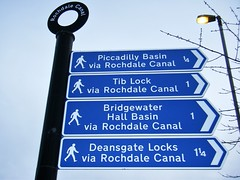 Manchester = Rochdale Canal sign (rossendale2016) Tags: indicators indicator mooring moored accomodation living owned owner residential boat house houseboat blue mileage victorian old water banks sailing walking distance signpost locks deansgate hall bridgewater lock tib centre city manchester barge sign basin piccadilly canal navigatable rochdale