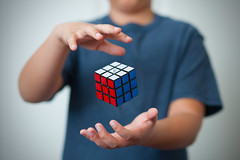Noah's Turn (nophoto4jojo) Tags: activeassignmentweekly rubiks cube solve puzzle photoshop cs6 magic hands boy 9 red white blue nikkor 85mm f18 d700 sb600 nikon bestofweek1 bestofweek2 bestofweek3