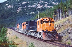 .(SEE & HEAR)---Cartier 48 74 77 sb mp22.5 QUE. 9-23-2000 (jackdk) Tags: train railroad railway locomotive alco mlw mlw636 mlwm636 c636 alcoc636 cartier cartiermining ore oretrain orejenny quebec portcartier wilderness