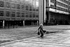 By attacking the place (pascalcolin1) Tags: paris institutdumondearabe femme woman canne cane place photoderue streetview urbanarte noiretblanc blackandwhite photopascalcolin 50mm canon50mm canon