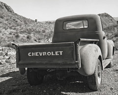 2017 in my Rear Window (magnetic_red) Tags: truck chevrolet chevy old rusted tailgate mountains desert blackandwhite tmax100 caffenol graflex crowngraphic window rear vintage