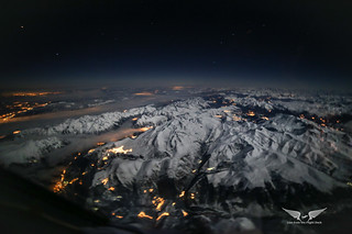 The Alps lit up by a bright moon, flying from Belgium to Italy