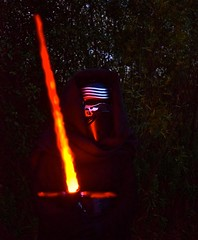 Star Wars (Bo Dudas) Tags: starwars star starwarscosplay costume cosplay light lightsaber kylo fight orange battlke mask night dark nikon nikkor movie character fire plasma flame sword evening film jedi battle battlefront lastjedi theatre theater outdoors outside nature disney