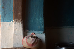 Sacred in Mundane. (Gattam Pattam) Tags: abstract blue brown rural house bundle bag wood wall mud architecture