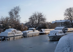 Boats under snowy blankets. (Country Girl 76) Tags: narrow boats cruisers canal leeds liverpool snow blankets trees ice cover sky winter frost