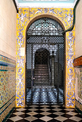 Cadiz, Spain (Marian Pollock) Tags: doorway arch door wroughtiron tiles frescoes checks stairway cherubs yellow cadiz spain europe gate pattern
