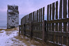 Crumbling history (Len Langevin) Tags: grainelevator old abandoned derelict decay crumbling deterioration alberta canada fence weatheredwood nikon d7100 tokina 1224