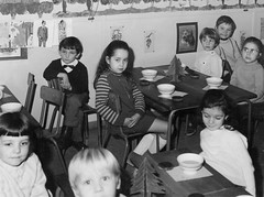 Before the main photo (theirhistory) Tags: boys children kids clothing france girl classroom table chair dress jumper trousers wellies cup boots