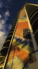 Hilton Tower (Thad Zajdowicz) Tags: zajdowicz hawaii usa travel availablelight honolulu leica lightroom waikiki beach sky building architecture mural painting publicart color colour light shadow outdoor outside vertical hilton tower hotel clouds blue white orange yellow red art abstract